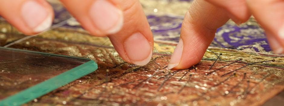 Imatge pràctiques de restauració tèxtil